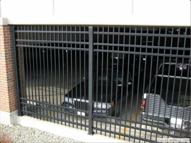 Global metal works and erectors for Garage fence